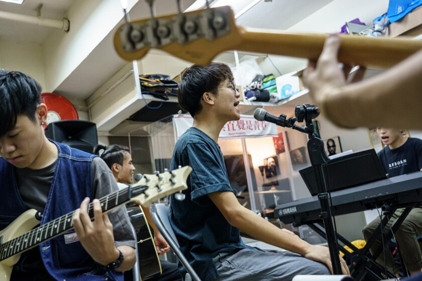Lead singer Ben Chan and Boyz Reborn rehearse in Hong Kong. The boy band has become more political.