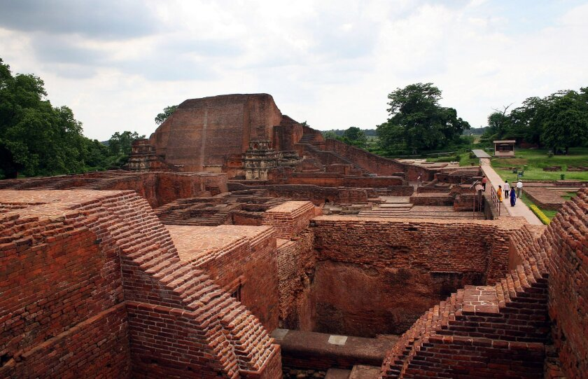 FILE � In this July 5, 2006 file photo, tourists walk at the ruins of the Nalanda University at Nalanda, India. UNESCO has put four new sites on its World Heritage List, including the archaeological site of Nalanda Mahavihara, or Nalanda University, on Friday, July 15, 2016. (AP Photo/Prashant Ravi