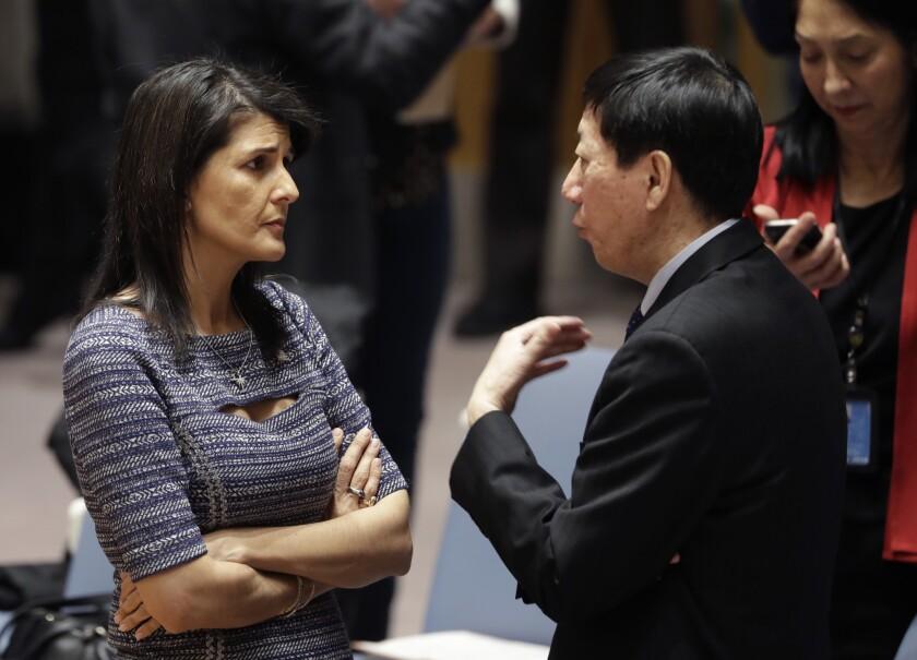 U.S. Ambassador to the United Nations Nikki Haley talks with Chinese deputy ambassador Wu Haitao, Fr