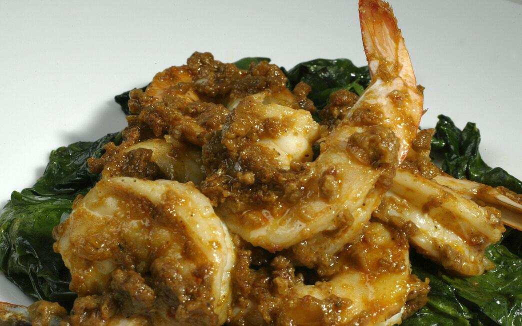 Shrimp in romesco with wilted spinach