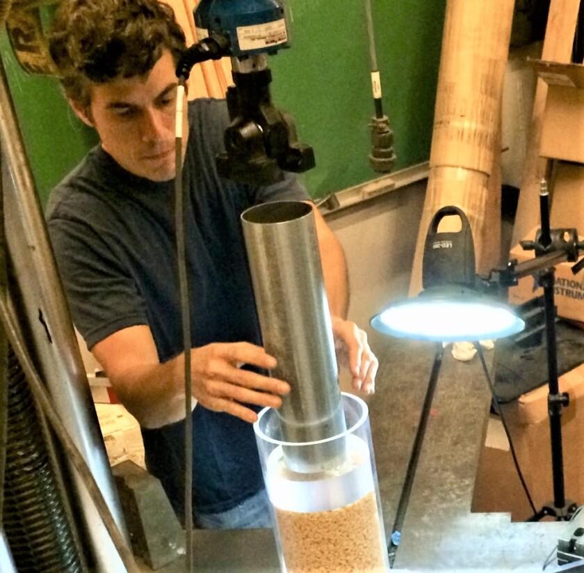 SDSU engineering Professor Julio Valdes crushes Kellogg's Rice Krispies in a controlled test.