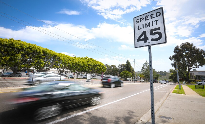 SAN DIEGO, CA 4/19/2019: Traffic heads east on Balboa Avenue near the corner of Claremont Drive in Claremont, near a speed limit sign. The speed limit is not radar enforceable because the roadway hasn't been surveyed for actual speed limits. (Howard Lipin/ The San Diego Union-Tribune)