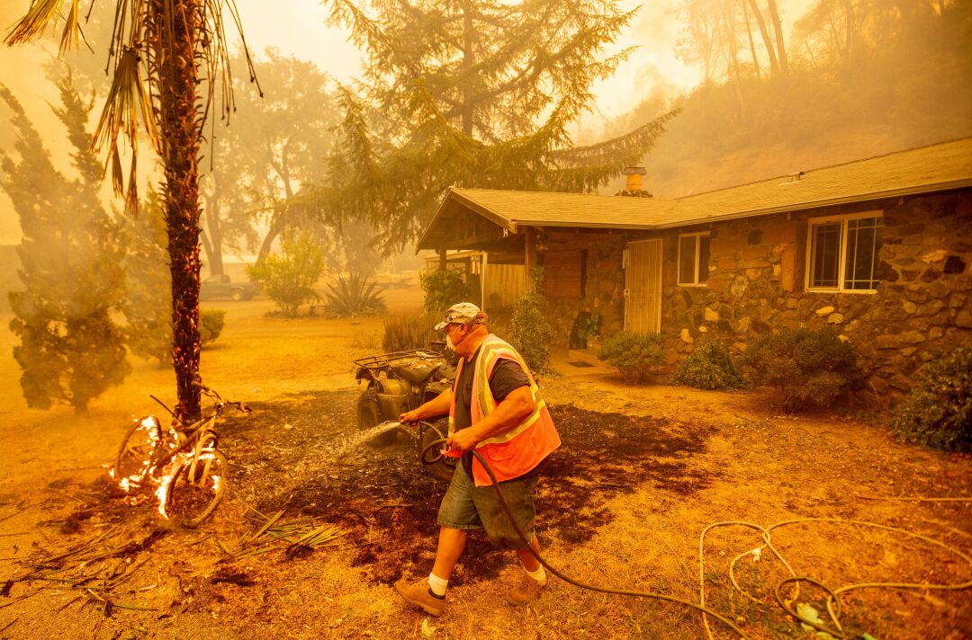 A resident guards a house in Napa County.