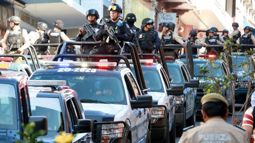 A convoy carrying federal, civil and state police personnel arrives in March in Jalapa, Veracruz sta