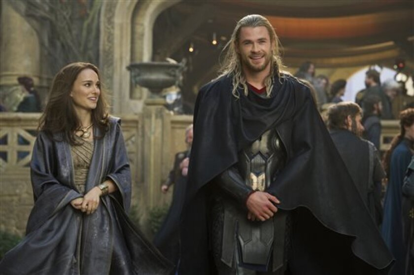 """FILE - This publicity photo released by Walt Disney Studios and Marvel shows Natalie Portman, left, as Jane Foster and Chris Hemsworth as Thor, in Marvel's """"Thor: The Dark World."""""""