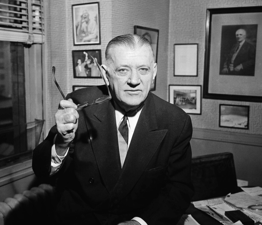 FILE - In this Feb. 13, 1957, file photo, NFL Commissioner Bert Bell gestures in his office in Philadelphia. Bert Bell was not the first NFL commissioner. He was, however, the first to make a major impact on pro football. To call Bell the father of the NFL draft would be accurate. It also would be an incomplete assessment, because Bell was a brilliant innovator who helped carry his league from afterthought to a player among American sports. (AP Photo/Warren M. Winterbottom, File)