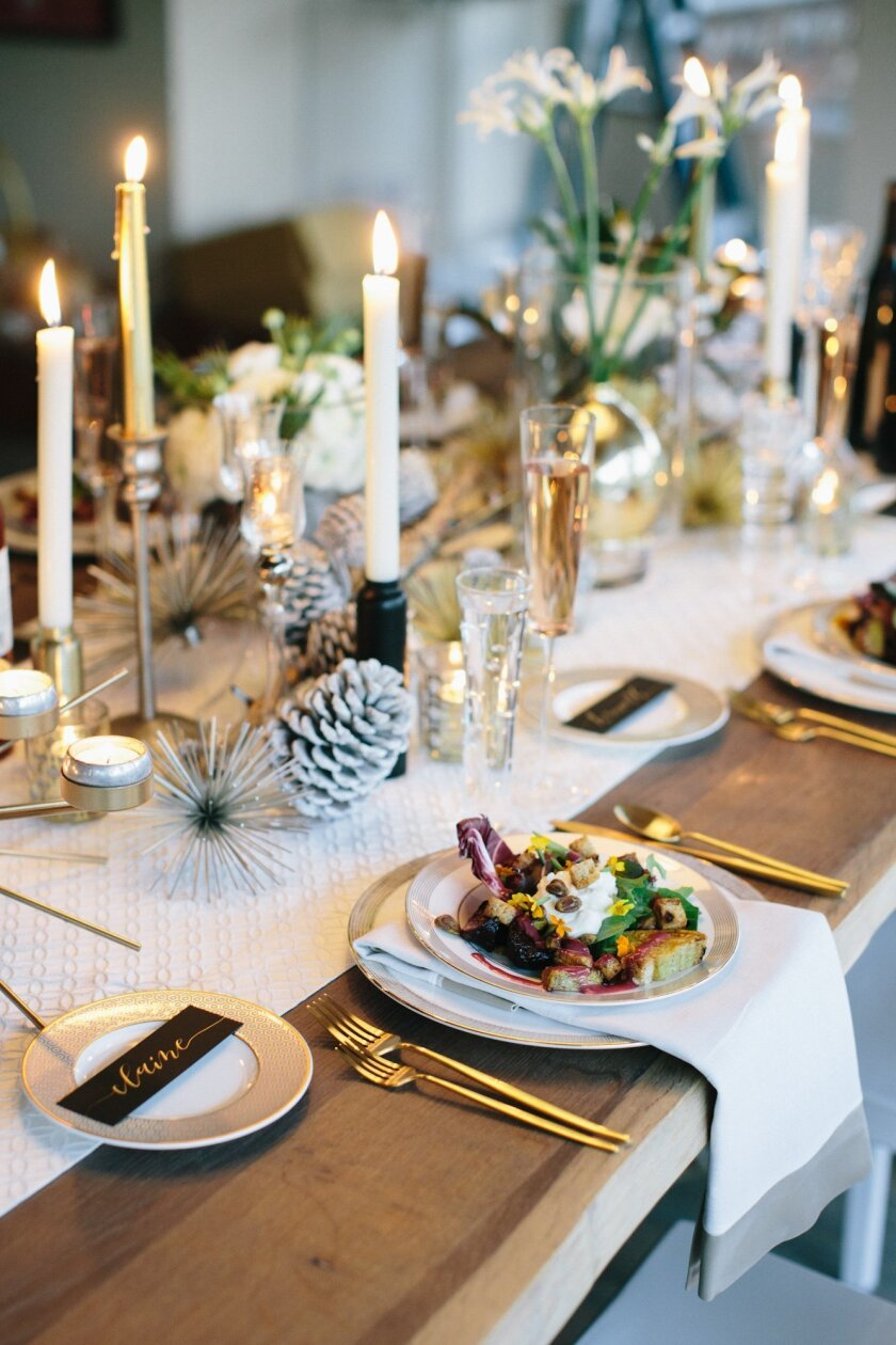 Waters Fine Food and Catering sets up an elegant winter tablesetting featuring a seasonal winter beet trio salad with pomegranate blood orange vinaigrette, Laura Chenel's goat cheese and assorted winter lettuces.