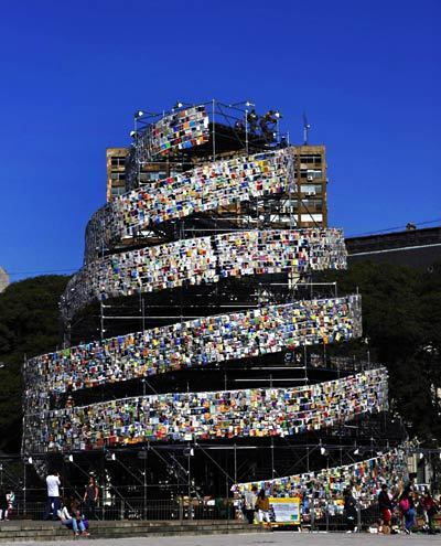 The installation was constructed with books donated by more than 50 countries. In biblical literature, the Babylonians were constructing a grand city to raise their profile, and it included a tower that would reach the heavens, the Tower of Babel. Seeing this, God dispersed them and gave them different languages so they couldn't communicate with one another. The city and tower were never finished.