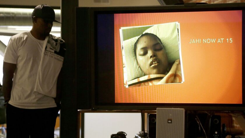 FILE - In this Dec. 23, 2015 file photo, a recent photo of Jahi McMath is shown on a video screen ne