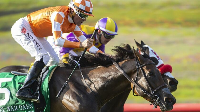 Fatale Bere and jockey Kent Desormeaux, outside, outleg Ollie's Candy, inside, with Tyler Baze, to win the Grade I, $300,000 Del Mark Oak horse race Saturday, Aug. 18, 2018, at Del Mar Thoroughbred Club in Del Mar, Calif.