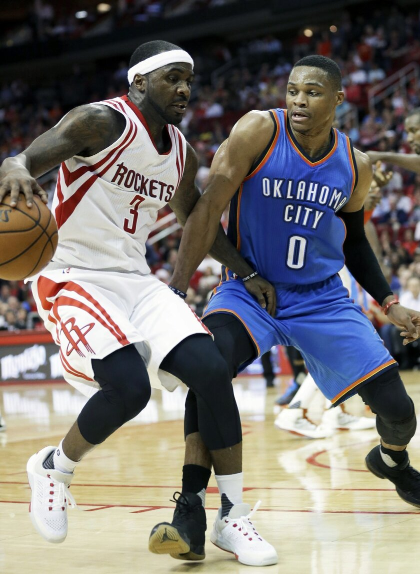 Houston Rockets' Ty Lawson (3) and Oklahoma City Thunder's Russell Westbrook get tangled up in the second half of an NBA basketball game Monday, Nov. 2, 2015, in Houston. The Rockets won 110-105. (AP Photo/Pat Sullivan)