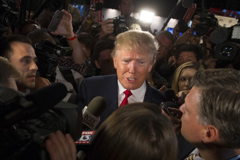 Donald Trump is mobbed by media outlets after the first Republican presidential debate. His lead in the polls has led publisher Thomas Dunne to move up the publication date of a new biography -- twice.