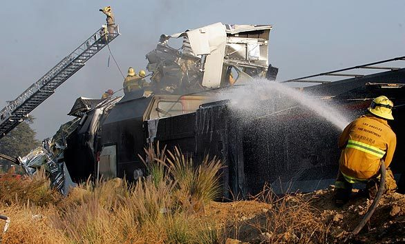 A Los Angeles firefighter douses the smoldering wreckage of Metrolink's Train 111, which left Union Station in Los Angeles at 3:35 p.m. and was headed to Moorpark. The collision occurred at 4:23 p.m. in Chatsworth.