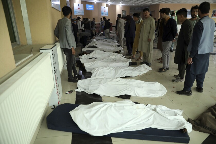 Bodies are lined up at a hospital after an explosion near a school in Kabul, Afghanistan, on Saturday.