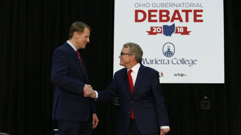 Democratic gubernatorial candidate Richard Cordray, left, and Ohio Attorney General and Republican g