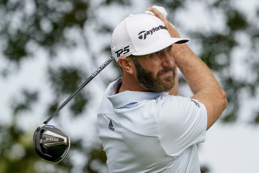Dustin Johnson, of the United States, tees off the ninth hole during a practice round for the US Open Golf Championship, Wednesday, Sept. 16, 2020, in New York. (AP Photo/Charles Krupa)