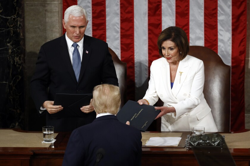 President Trump hands copies of his State of the Union speech to House Speaker Nancy Pelosi (D-San Francisco) and Vice President Mike Pence before delivering the address.