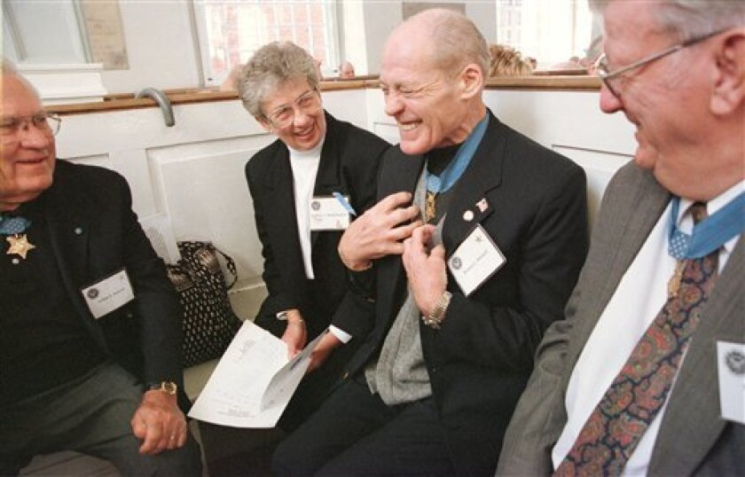 FILE - In this Saturday, Oct. 27, 2001 picture, Congressional Medal of Honor recipient Robert Howard, second from right, talks with others before the start of a memorial service at the Old North Church in Boston. Howard, considered to be the country's most decorated soldier has died. Oak Crest Fune