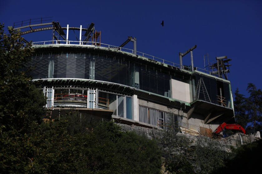 Mohamed Hadid's unfinished mansion in Bel-Air is bigger than city rules allow, officials say.