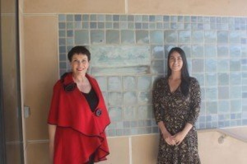 La Jolla Community Center Board CEO Ruth Yansick and Executive Director Nancy Walters in front of the new donor wall. Ashley Mackin