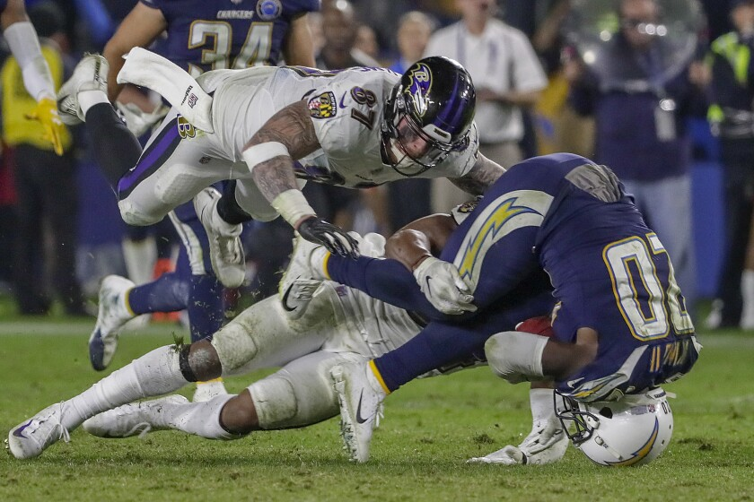 Chargers punt returner Desond King is toppled after 24-yard return late in the game against the Baltimore Ravens at StubHub Center on Saturday.