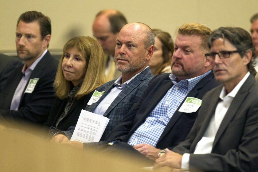 Randy Goodson, center, CEO of Accretive Investments, listens during a 9-hour County Planning Commission hearing in September. The commissioners voted 4-3 to recommend Goodson's Lilac Hills Ranch housing project be approved.