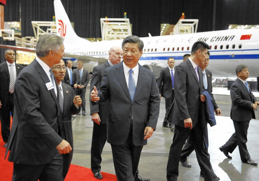 Chinese President Xi Jinping tours a Boeing plant in Washington state.