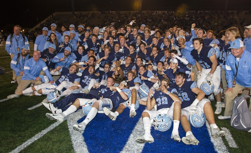 Corona del Mar High School's football team celebrates after defeating Serra 35-27 in the CIF State Division 1-A title game at Cerritos College on Dec. 14.