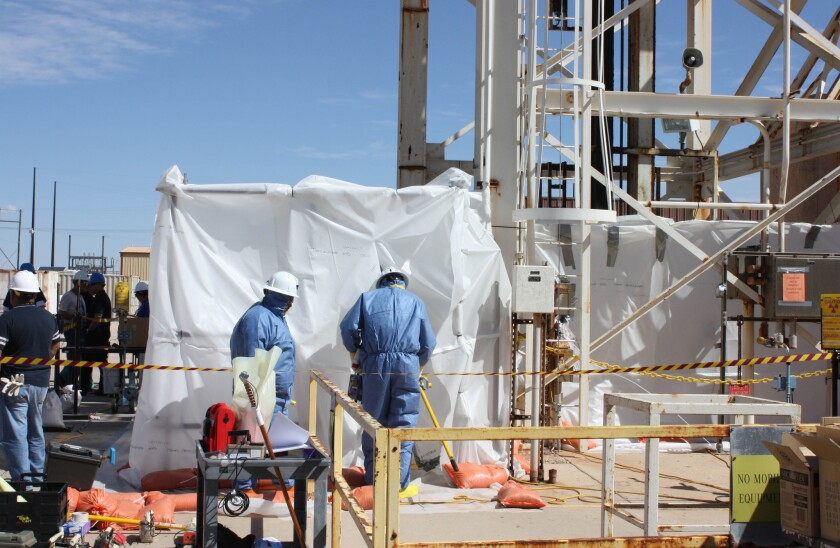 Workers conduct remote tests inside an underground nuclear waste dump in Carlsbad, N.M., earlier this month after a fire and radiation leak at the facility.