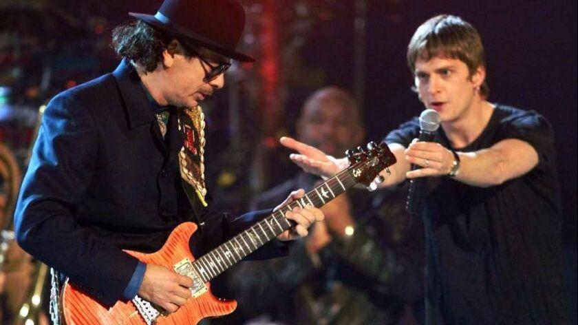 Rob Thomas (right) performs in 2000 with former Tijuana guitarist Carlos Santana, Thomas co-wrote Sa