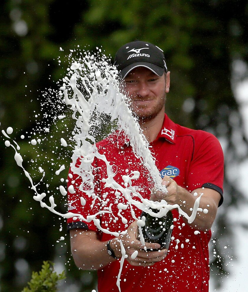 England's Chris Wood celebrates after winning the PGA Championship at Wentworth Club, in Virginia Water, England, Sunday May 29, 2016.  Wood shot a front-nine 29 before overcoming a late run of bogeys to win the PGA Championship by one stroke for the biggest victory of his career on Sunday. (Steve