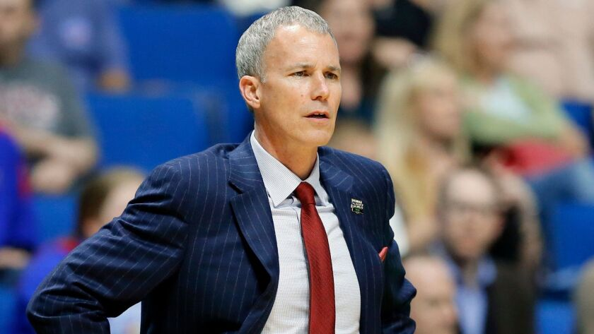 Andy Enfield has coached the Trojans to a 70-64 record in four seasons at USC.