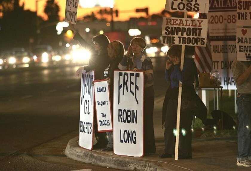Antiwar activists held their third monthly vigil last night across Miramar Road from the Miramar air station's north gate. San Diego County's community of peace protesters have taken up the cause of Pvt. Robin Long, a war resister.