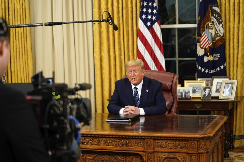 President Trump  addresses the nation from the Oval Office  on Wednesday night.