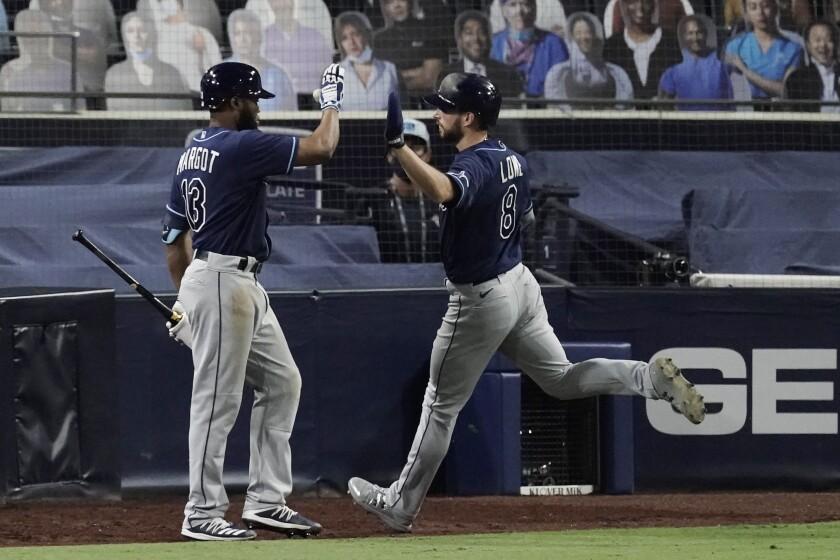 Tampa Bay Rays' Brandon Lowe celebrates with teammate Manuel Margot.