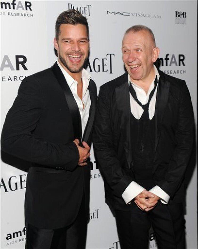 Honorees, singer Ricky Martin, left, and designer Jean-Paul Gaultier arrive at amfAR's 'New York Inspiration Gala' celebrating Men's style at The New York Public Library on Thursday, June 3, 2010 in New York. (AP Photo/Evan Agostini)