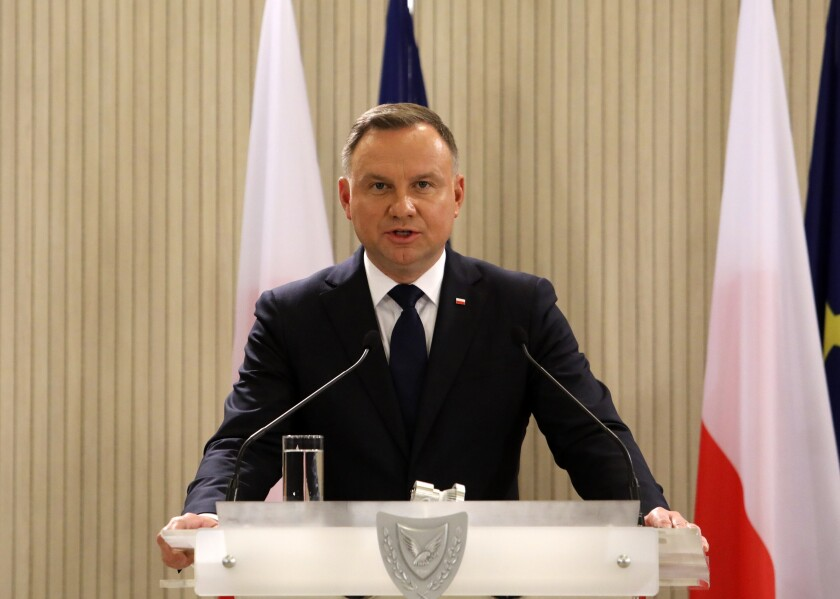 Polish President Andrzej Duda makes statements during a press conference with the Cypriot President Nicos Anastasiades at the Presidential Palace in Nicosia, Cyprus, Thursday, Oct. 7, 2021. Duda is on a two-day official visit in Cyprus. (Yiannis Kourtoglou/Pool via AP)