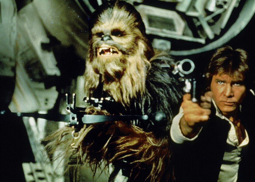 """Peter Mayhew as Chewbacca, with Harrison Ford as Han Solo in """"Star Wars,"""" is reprising his Wookiee role in """"Star Wars: Episode VII."""""""