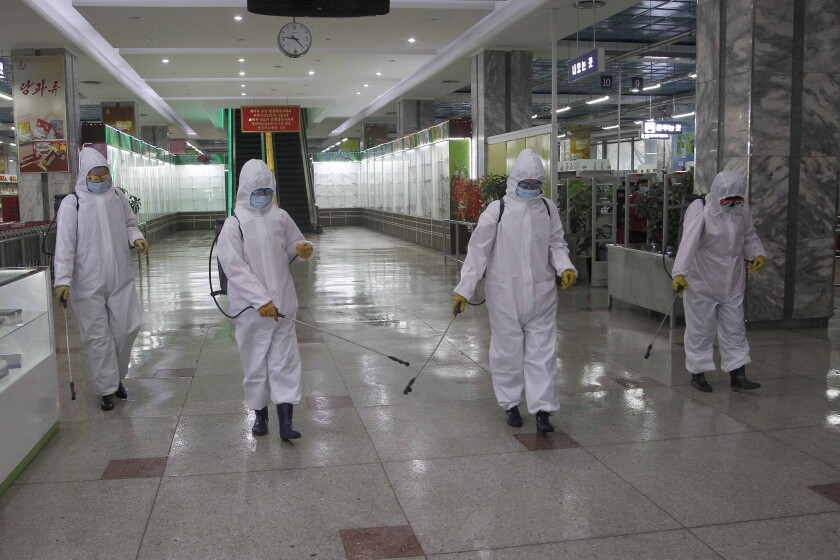 Pyongyang Department Store No. 1 staff disinfect the store