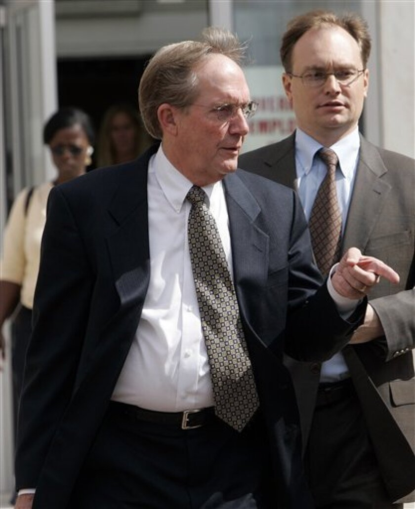 In this Sept. 25, 2008 file photo, Ronald Ferguson, former General Re CEO, leaves U.S. District Court in Hartford, Conn., after a pre-sentencing hearing. Ferguson has been sentenced, Tuesday, Dec. 16, 2008, to two years in prison and ordered to pay a $200,000 fine for his role in a scheme that cost shareholders of American International Group Inc. more than $500 million. (AP Photo/Bob Child, File)