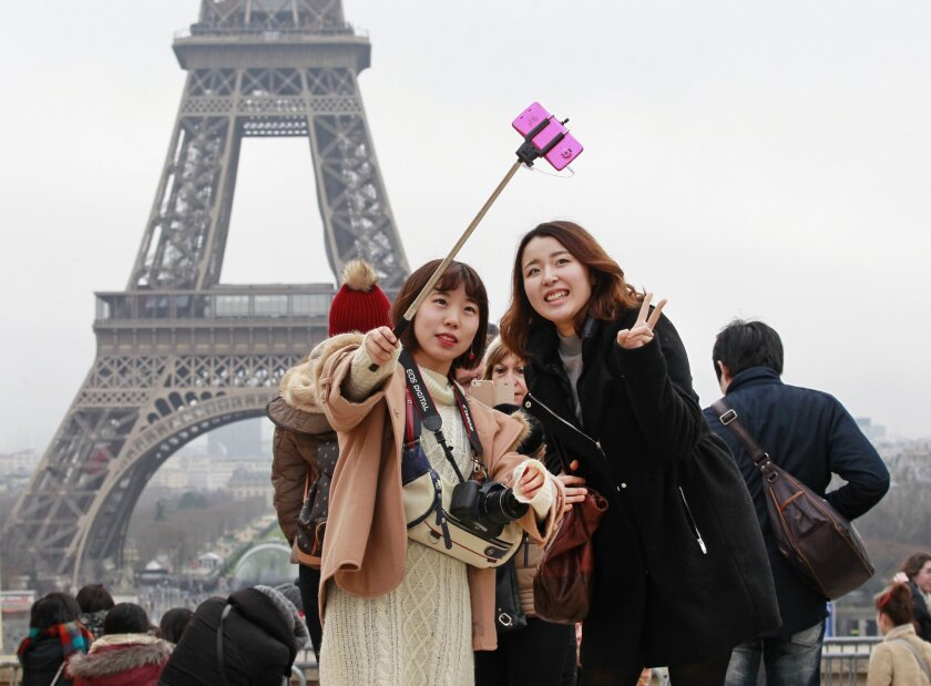 Selfie stick at the Eiffel Tower