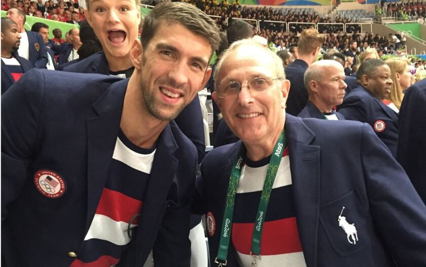 Tracy Sundlun at 2016 Olympics Opening Ceremonies posing with Michael Phelps.