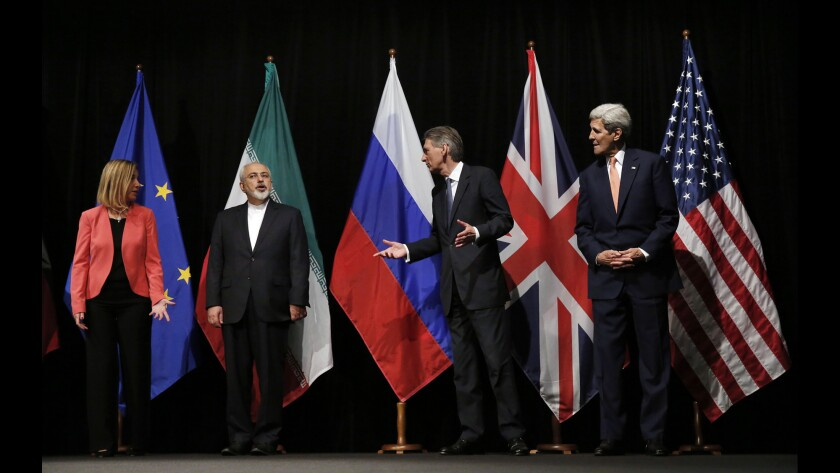 Then-Secretary of State John F. Kerry with his foreign counterparts after reaching the 2015 Iran nuclear deal.