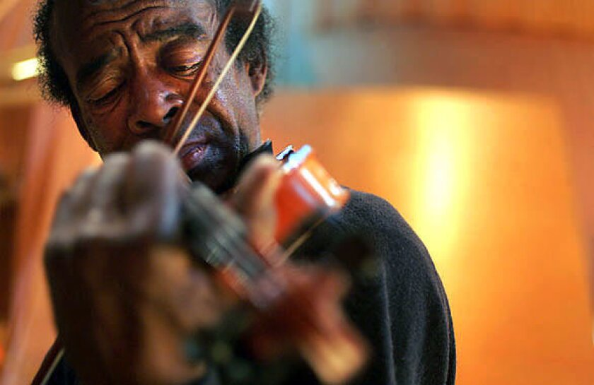 Music is the passion of Nathaniel Ayers, shown here playing the violin at Disney Hall in Los Angeles.