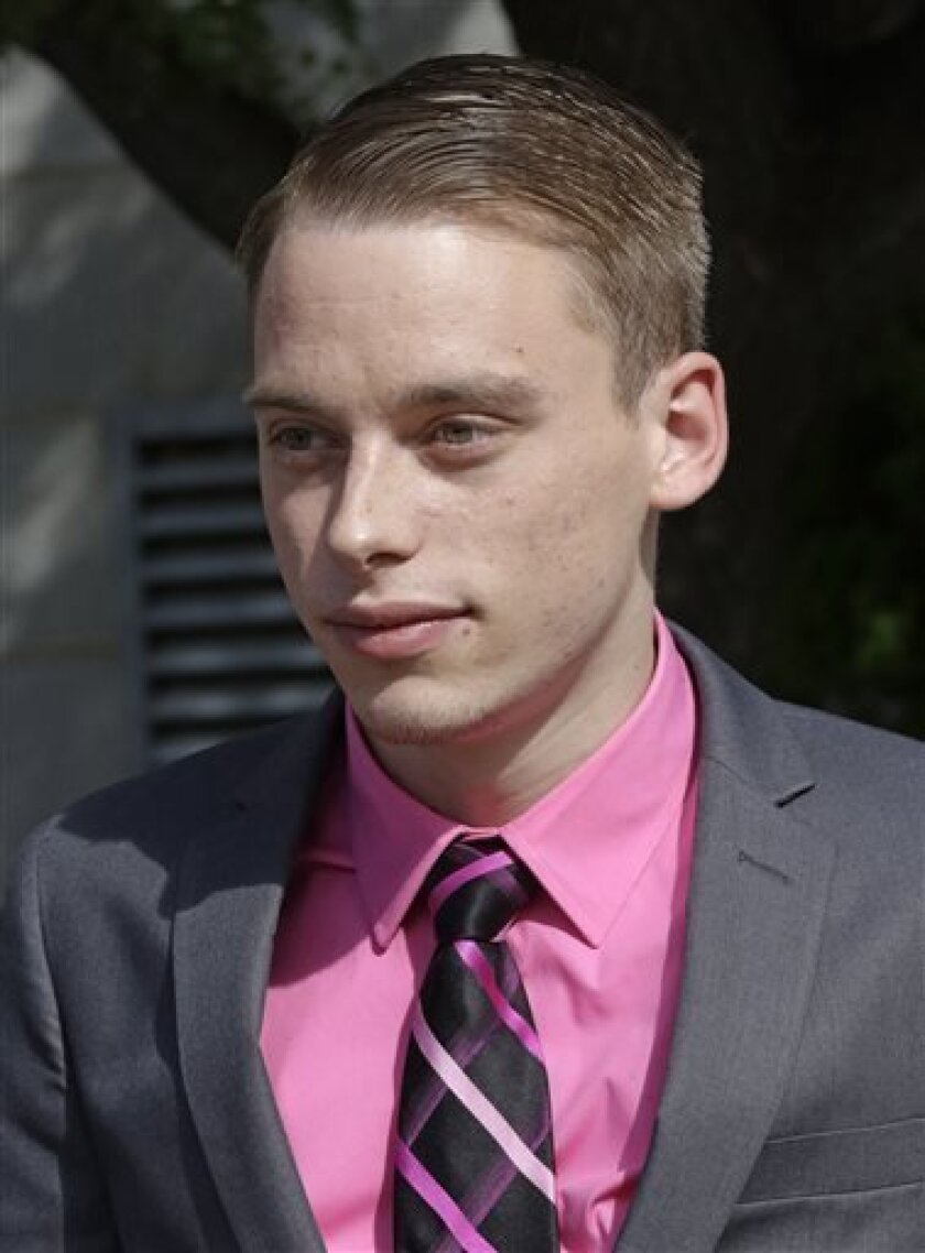 John Anthony Borell III walks from the U.S. District Court Thursday, Sept. 12, 2013, in Salt Lake City. Borell, 22, linked to the hacker collective Anonymous was sentenced Thursday to three years in federal prison for breaking into police and other websites across the country. Borell III of Toledo pleaded guilty to computer fraud in April and agreed to pay $227,000 in damages to computer servers that had to be repaired or beefed up for security. In early 2012, Borell attacked a server for Utahc