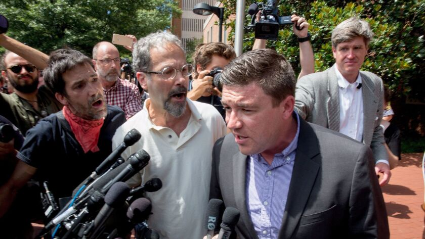 "Jason Kessler, right, organized August's ""Unite the Right"" rally in Charlottesville, Va."