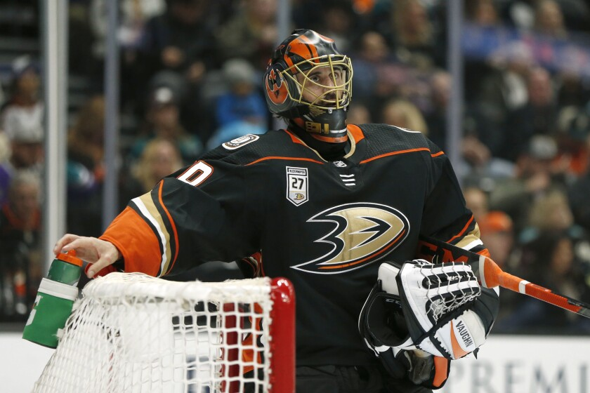 Ducks goalie Ryan Miller looks up during a break in the second period against the Washington Capitals at Honda Center on Feb. 17.