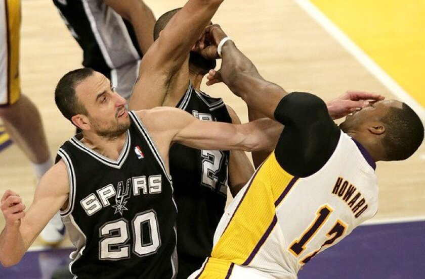Lakers center Dwight Howard is fouled by Spurs guard Manu Ginobili while trying to score against Ginobili and power forward Tim Duncan in the second quarter of Game 4 on Sunday.