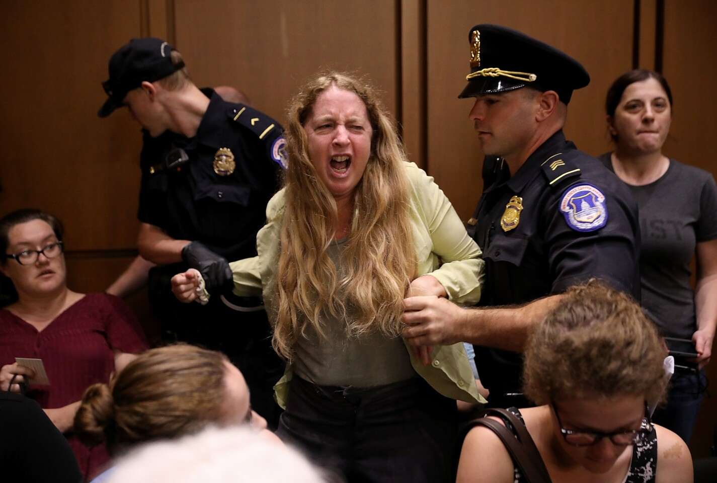 Protesters disrupt the confirmation hearing for Supreme Court nominee Judge Brett Kavanaugh before the Senate Judiciary Committee.
