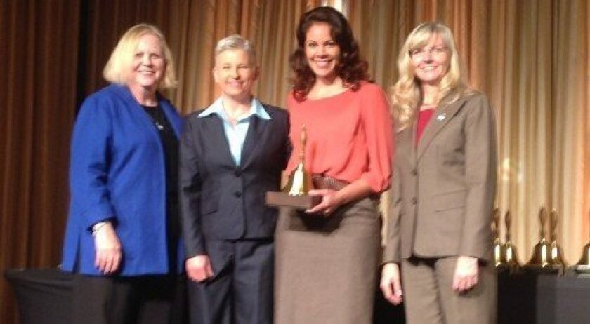 DMUSD Director of Pupil Services Cara Schukoske, second from left, and early childhood coordinator Marisa Tirri, third from left, accept the Golden Bell award in San Francisco.
